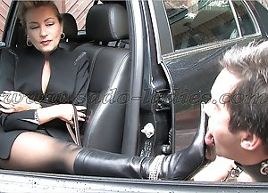 Rich business lady makes her slave licking her leather boots.