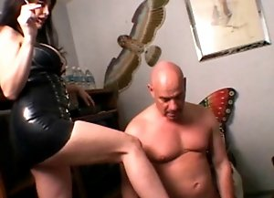 Humiliated bald hunk licks mistress's nice foots.