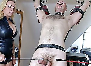 Restrained hairy slave taking painful cock and balls punishments from a couple of hot and utterly depraved mistresses