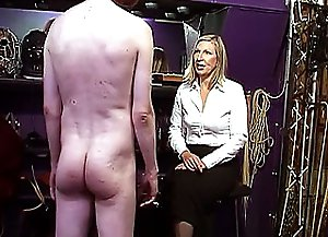 Horny blonde mistress orders her enslaved guy to put on wig first of all and then she begins spanking his tight ass using her strong hands and rod